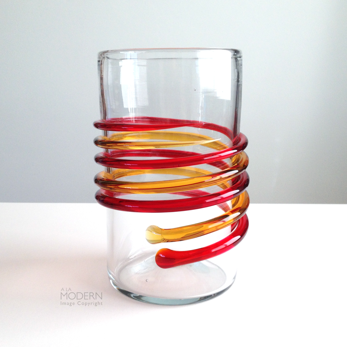 Blenko glass myers 6710a tangerine honey double spiral vase on a fantastic blenko glass tall clear cylindrical column vase with red and orange applied spiral helix design around side this is the number 6710a myers vase reviewsmspy